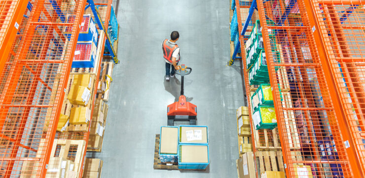 High angle view of Male warehouse worker